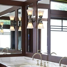Humboldt Linear Sconce lights contemporary master bath vanity of a period Prairie Style home