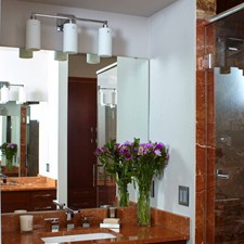 Three Light Tribeca Sconce lights a bathroom vanity