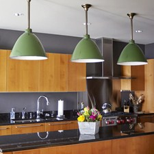 Storehouse Enamel Pendant Lights hang above a kitchen island