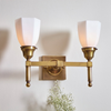 Two light fireplace sconces in brass finish