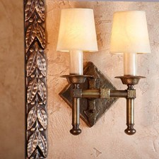 Hand Hammered Two Light Straight Arm Sconce with electric candles